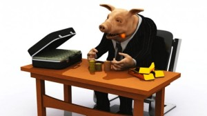 banker-pig-in-suit-counts-his-wealth-via-Shutterstock1-615x345