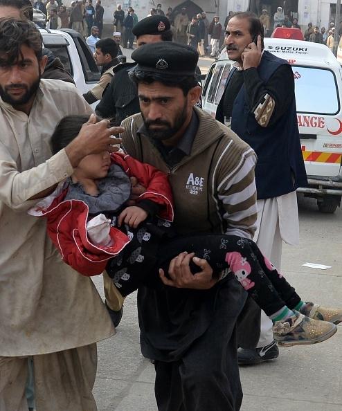 pakistan-taliban-peshawar-pakistani-men-carry-an-injured-school-girl-to-a-hospital-following-an-attack-by-taliban-gunmen-on-a-school-in-peshawar-on-december-16-2014